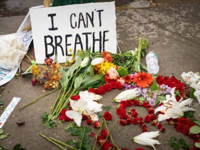 """Flowers and a sign reading """"I can't breathe"""" at the George Floyd memorial in Minneapolis"""