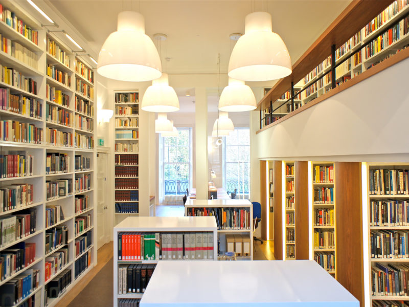Image of the Wolfson Reading Room featuring shelves of books, mezzanine floor, and enquiry desk.