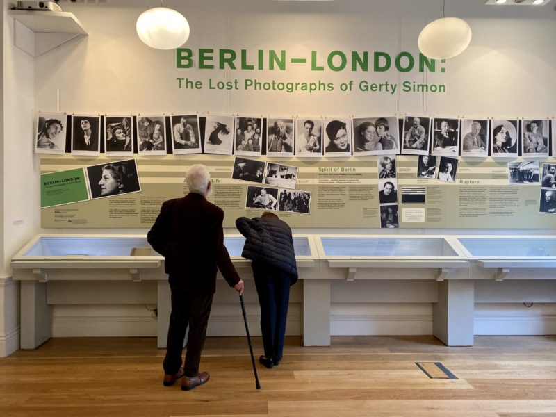 Two people examine cases as the 'Berlin/London: The Lost Photographs of Gerty Simon' exhibition.