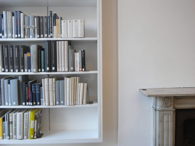 Bookshelves and fireplace in the Wolfson Reading Room