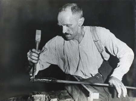 Black and white photograph of glass worker
