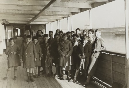 Image of group of people standing on a boat