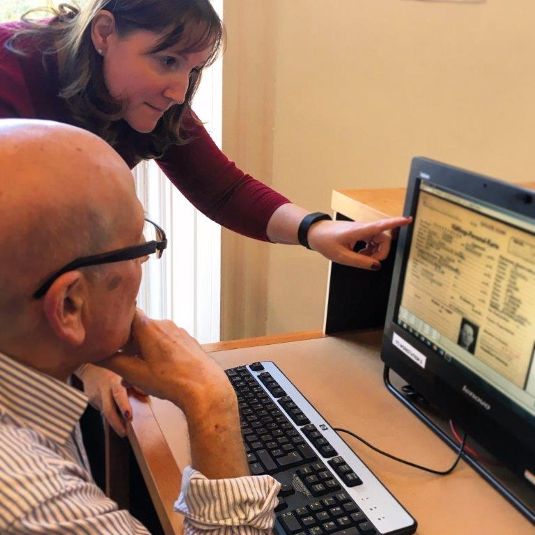 ITS Researcher Mary Vrabecz helping volunteer Brian Goldfarb navigate the International Tracing Service archive