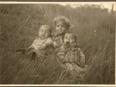 Photograph of three children in a field