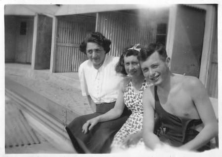 Image of three people sitting on wall