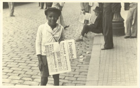 Image of boy selling a newspaper