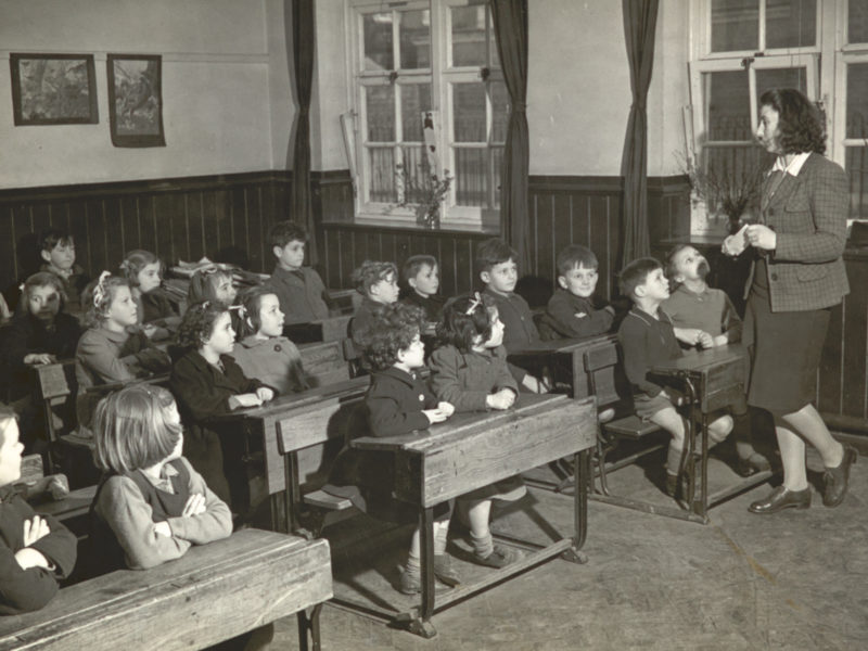 Black and white photograph of children in classroom