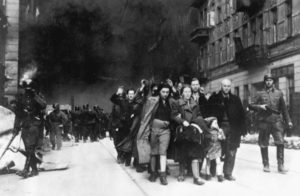 Black and white photograph of civilians being led away by army