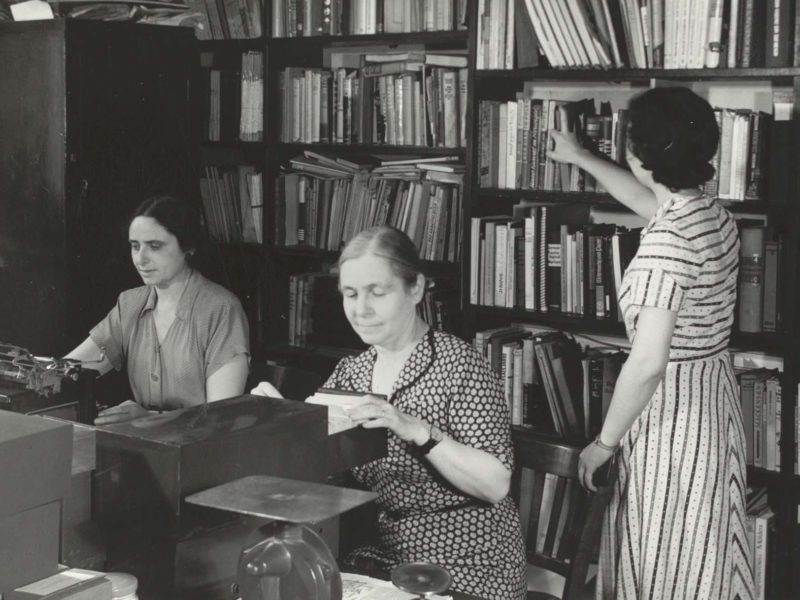 Black and white photograph of women in library