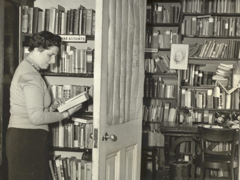 Woman in front of bookshelves