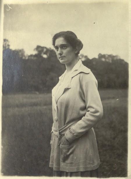 Side profile of woman wearing coat in field