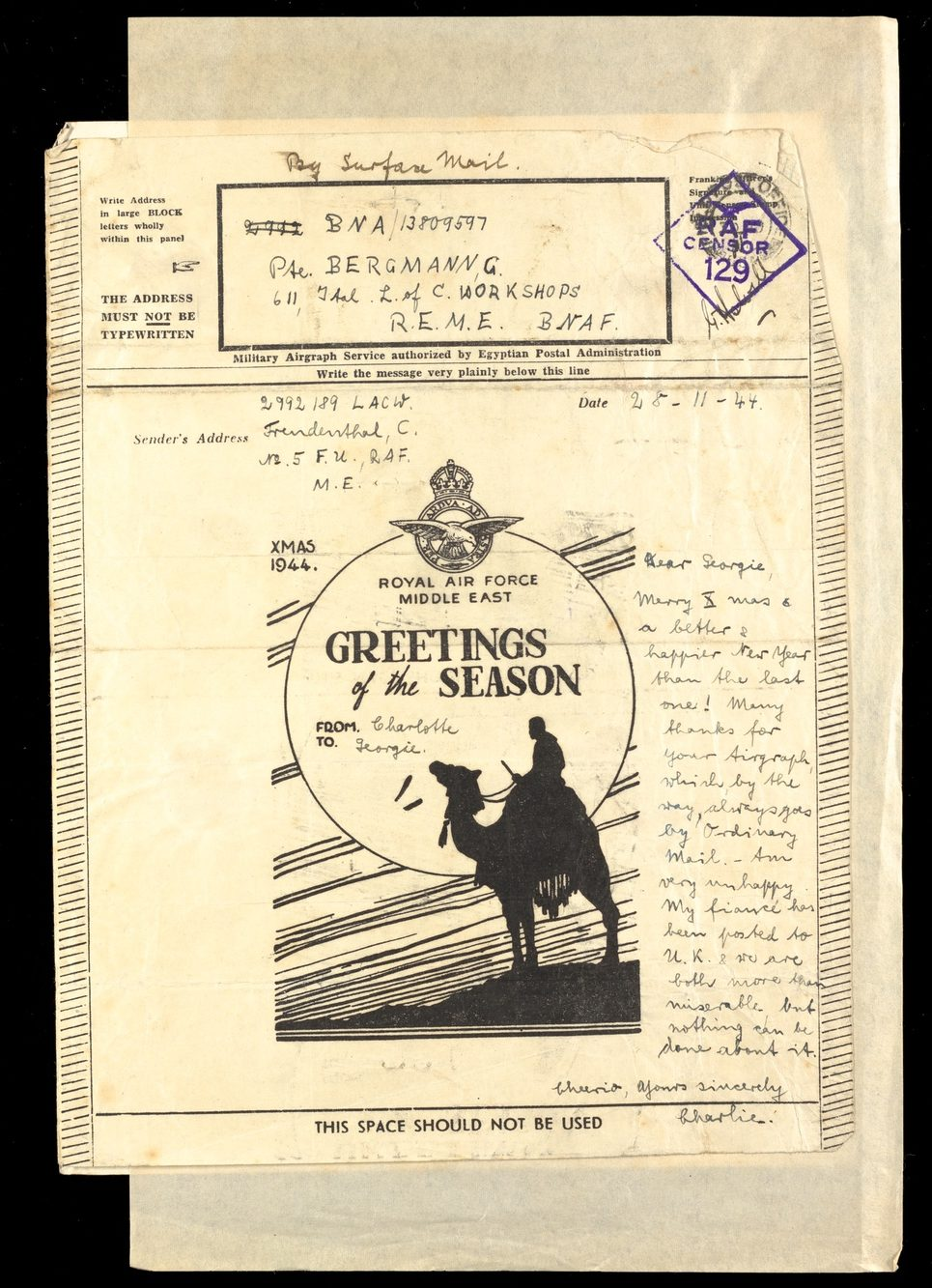 Printed image of a camel and note reading 'Greetings of the season'. Christmas note dated 1944