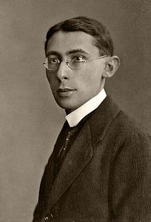 A portrait photograph of Hans Gal in a suit wearing glasses