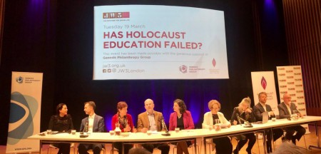 Panel of 9 individuals taking place in the 'Has Holocaust Education Failed?' event at JW3