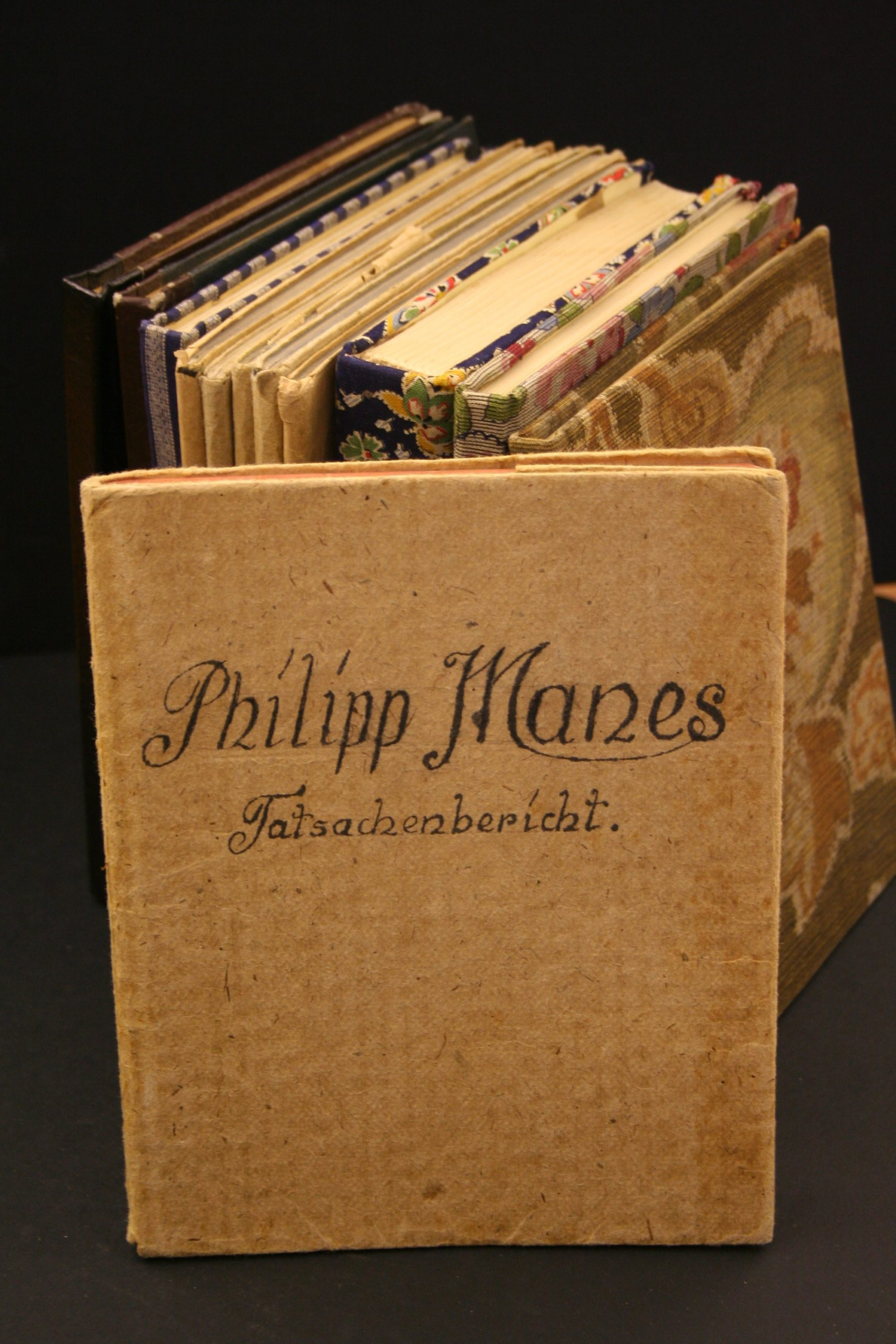 Stack of notebooks belonging to Philipp Manes