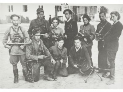Black and white image Abba Kovner and other Jewish Lithuanian partisans with guns