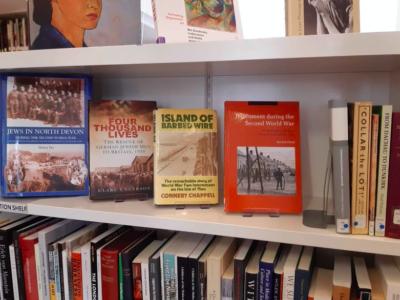 Bookshelf showing four books
