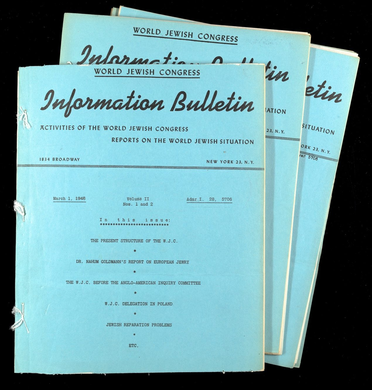Three issues of the World Jewish Reliefs Information Bulletin on blue paper