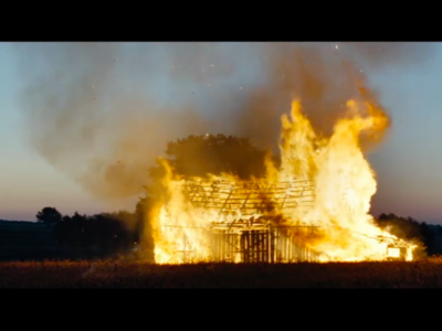 Still taken from 'Aftermath', (2012). Shows a burning barn