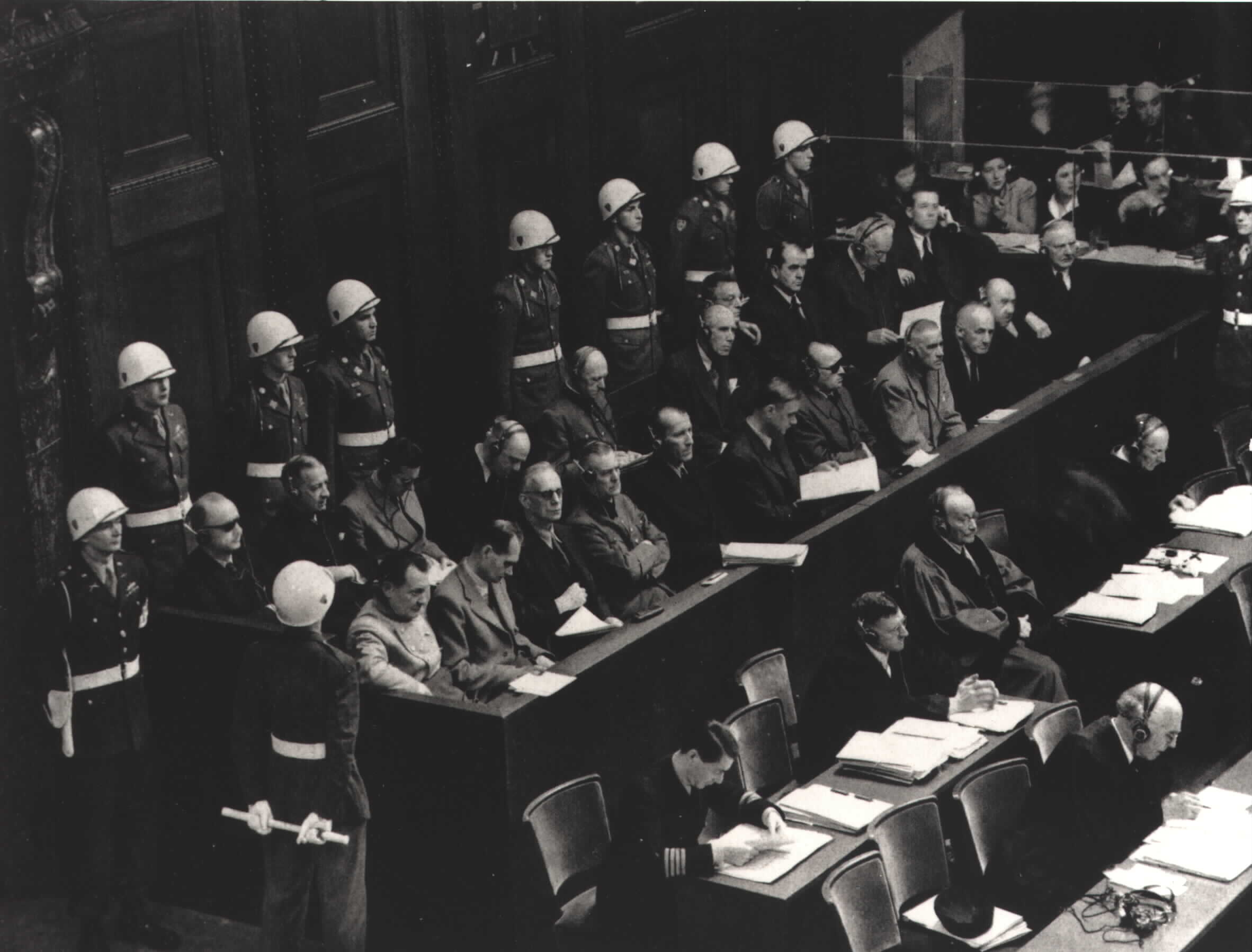 Black and white photographs showing people in a courtroom