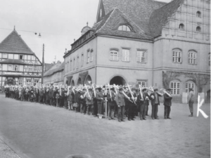 Black and white photograph from Gardelegen are assembled in the town square by US military authorities to march to the nearby cemetery