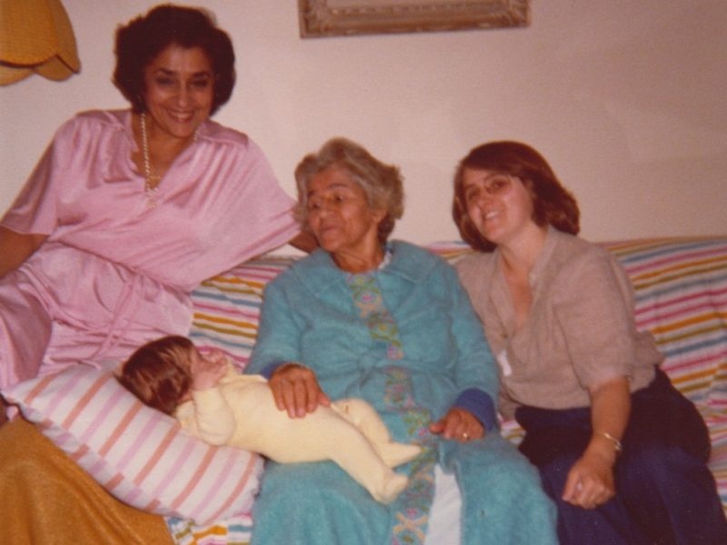 Three women and a young child photographed