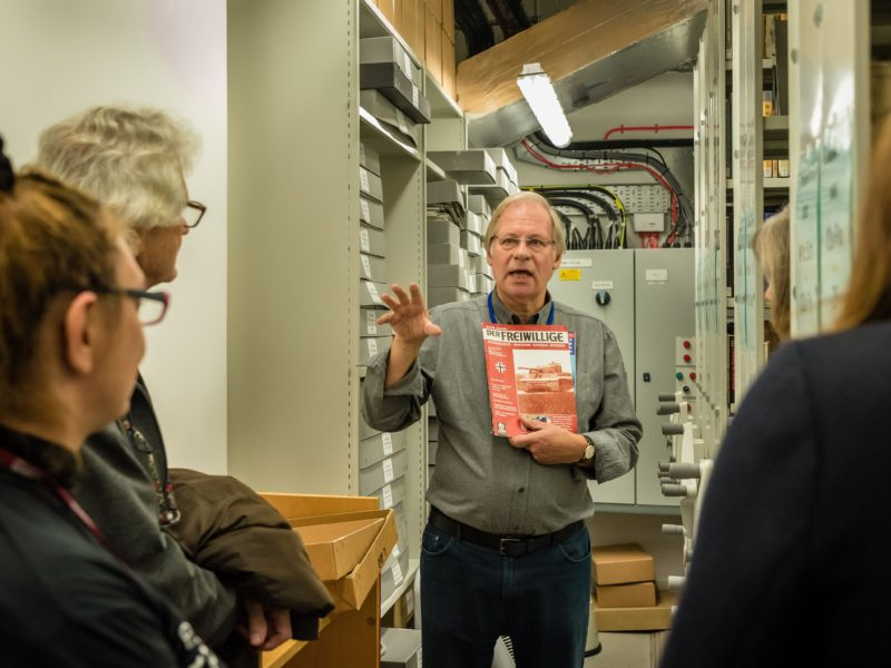 A volunteer guide shows unique items from the Library's collections