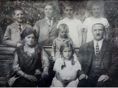 A black and white photograph showing a large family, pre WWII