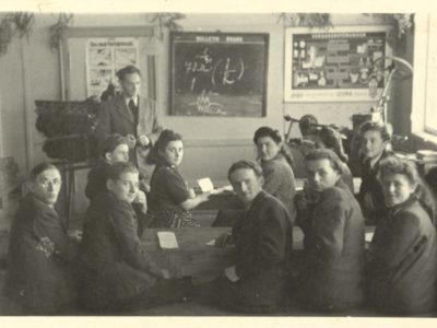 Black and white photograph of students taking a class postwar in a DP camp