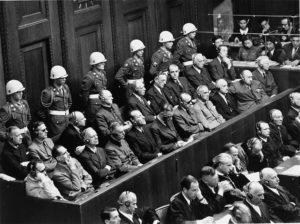 Men sitting in the docks during a criminal case at Nuremberg 1945