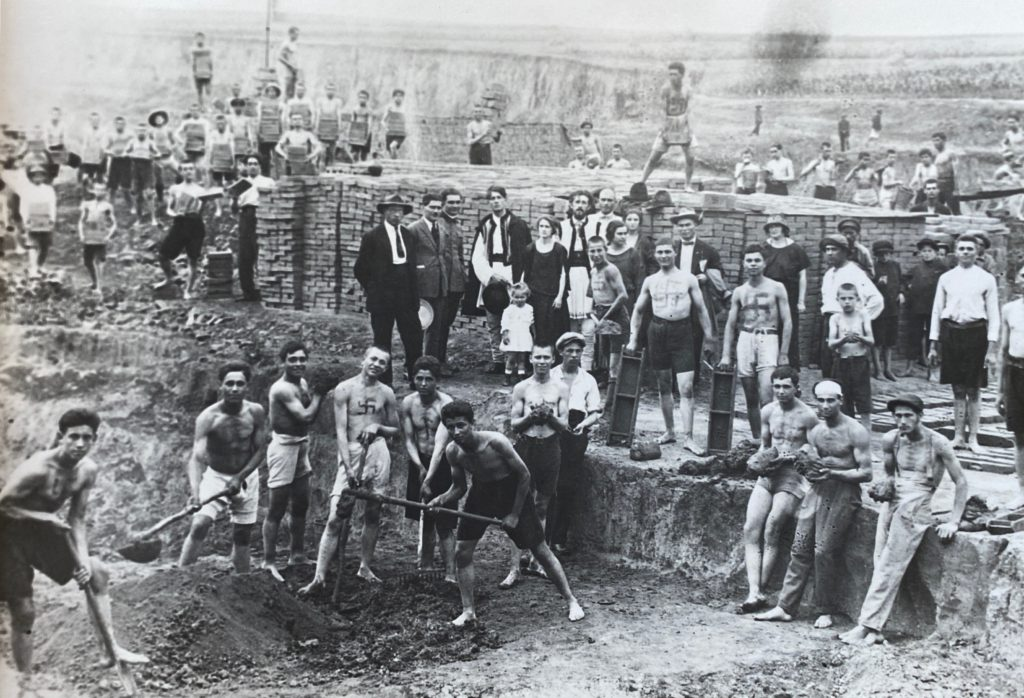 Romanian fascist young men working in a brickworks in the 1920s